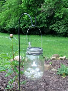 Hanging solar mason jar lantern with Dollar Tree plant hangers and solar lights. Easy low budget Garden DIY