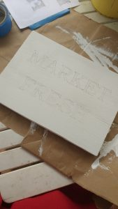 How to make a wooden sign, pencil outline of letters on sign from tracing