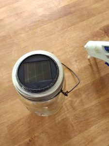 Hot glue the rim to make hanging solar mason jar lights