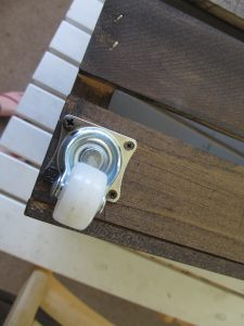 The caster wheels are attached to the crates with a screw driver