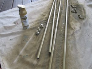 Spray paint conduit pipe and brackets to create custom curtain rods