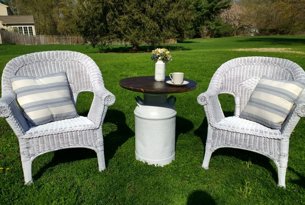 Finished wicker chairs and milk can table