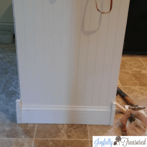 Adding beadboard and molding to upgrade basic cabinets inbabdiy kitchen remodel #kitchendiy #homediy #homemakeover