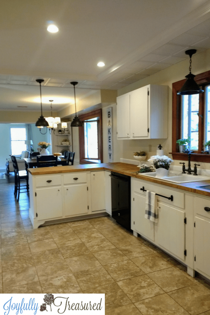 Farmhouse kitchen remodel on a budget with painted white cabinets, butcher block countertops, recessed