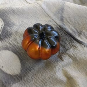 Spray the stem of the pumpkin with brown paint