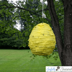 DIY Beehive pinata with newspaper mache and crepe paper. Easy diy teddy bear picnic party decoration #partydecor #picnic #birthday #party