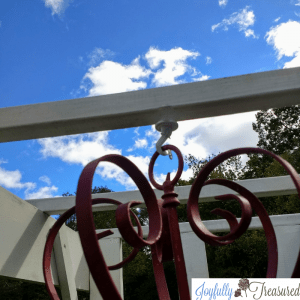 Hanging the DIY outdoor solar chandelier, Upcycle an old Chandelier into functional garden art! #gardenideas #upcycle #solarlights
