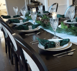Make a neutral winter tatablescape with greenery from the yard and simple affordable supplies. Create easy decor that lasts beyond the holidays. #tablescape #neutral #farmhouse #christmasdecor #winterdecor
