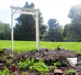 arbor anchored in garden