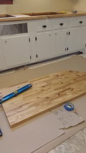 Apply a coat of oil to the underside of the butcher block