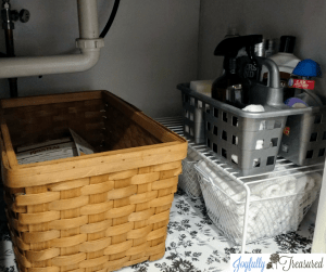 Organize under the kitchen sink with simple supplies you can find at the dollar store