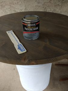 Stain and seal the round table top
