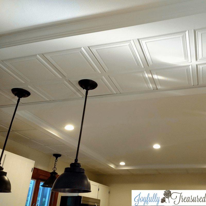 Tray ceiling install using a border of decorative drop ceiling tiles
