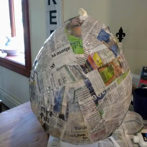 Beehive pinata made with newspaper paper mache over a baloon