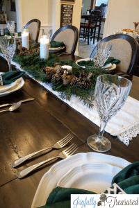 Create a neutral winter tablescape and natural Christmas decor using fresh greenery and affordable supplies. Make an easy DIY table centerpiece that works through the holidays and into winter. #winterdecor #neutraldecor #farmhousechristmas #tablescape #christmas