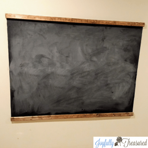 Easy DIY wall mounted schoolhouse chalkboard for under ten dollars. Great idea for the playroom! #budgetdecor #playroom #craftideas #homediy #farmhouse #budgetdecor
