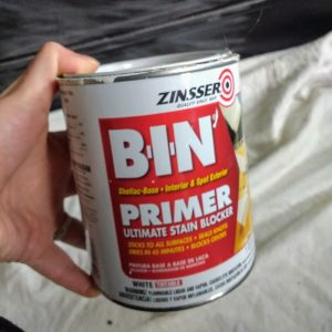 bin primer. Use a quality primer for painting over laminate furniture