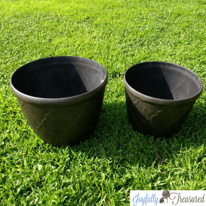 Create a DIY solar fountain planter for the garden using flower pots