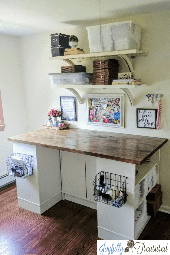 Create a simple craft table with ikea shelves and butcher block. Finish\ butcher block with dark walnut stain and wood bowl finish, our butcher block shipping craft table. Feminine farmhouse home office decor. #homeoffice #girlboss #workfromhome #homediy #officedecor#budgetdecor