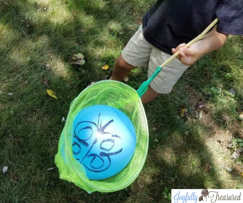 Butterfly balloon catch game, easy camping themed birthday party idea