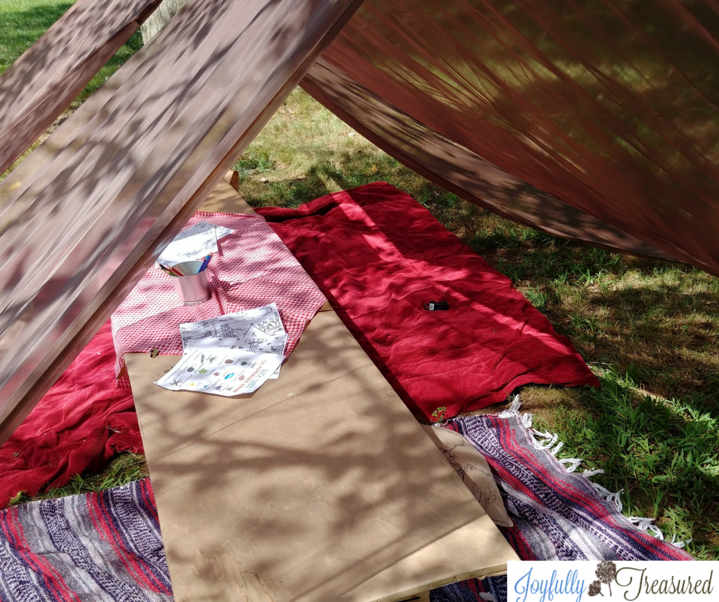 Camping themed birthday party. DIY tent party decor made with curtains and clothesline!