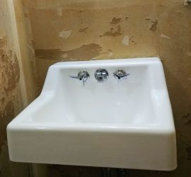 painting the bathroom sink, easy DIY bathroom makeover using Rustoleum tub and tile refinishing kit. makeover this dated 1960's powder room to farmhouse style for just $100! #budgetdecor #homediy #bathroomdiy #budgetreno #beforeandafter
