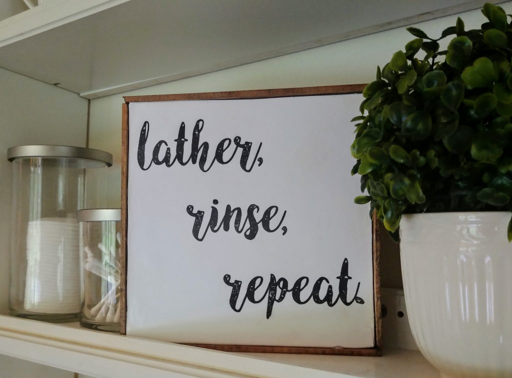 DIY dollar tree decor idea, Make a farmhouse style sign from a dollar tree sign with this easy tutorial. I am so happy this was only a dollar, and assembled in minutes! Part of a 1960's  bathroom makeover to farmhouse style for only $100. #dollartree #budgetdecor #diycraftideas