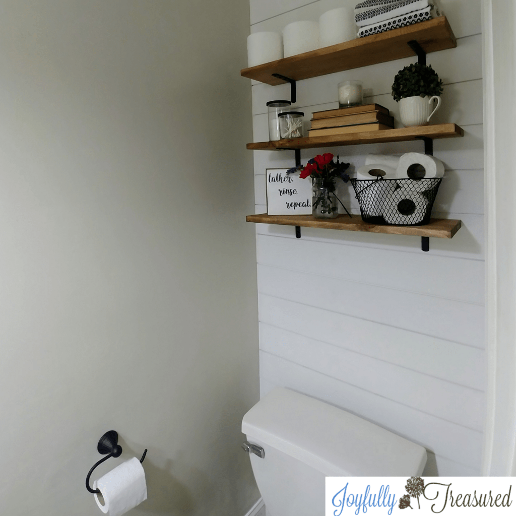 $100 room challenge. 1960's bathroom makeover with a $100 budget. Farmhouse style powder room makeover on a budget. #budgetdecor #homediy #farmhousestyle #beforeandafter #budgetreno #farmhousebathroom