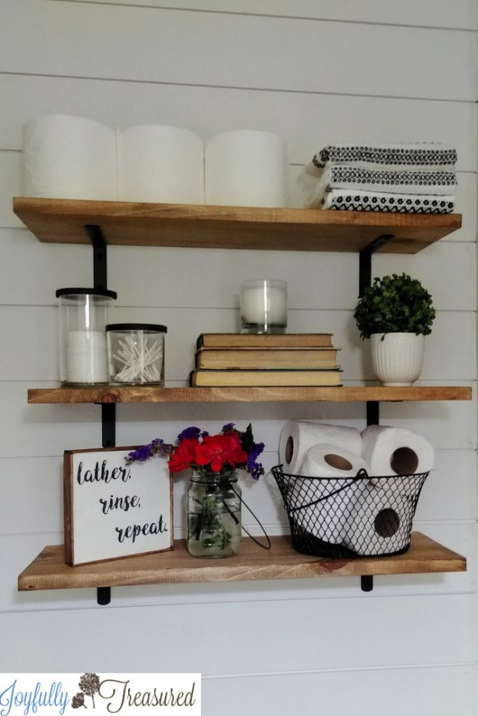 Easy DIY Farmhouse Shelves for less than $20! A shiplap accent wall and farmhouse shelves above the toilet for a $100 bathroom makeover. #budgetdecor #farmhousestyle #shiplap #farmhousebathroom #homediy